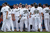 Ben Breazeale (39) of the Wake Forest Demon Deacons is congratulated by his teammates as he returns to the dugout after hitting a solo home run in the bottom of the first inning against the Florida Gators in Game Two of the Gainesville Super Regional of the 2017 College World Series at Alfred McKethan Stadium at Perry Field on June 11, 2017 in Gainesville, Florida.  (Brian Westerholt/Four Seam Images)