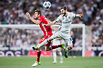 Nacho Fernandez (r) of Real Madrid battles for the ball with Thomas Muller of FC Bayern Munich during their 2016-17 UEFA Champions League Quarter-finals second leg match between Real Madrid and FC Bayern Munich at the Estadio Santiago Bernabeu on 18 April 2017 in Madrid, Spain. Photo by Diego Gonzalez Souto / Power Sport Images