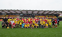 The teams and mascots line up pre match for photo during the Sellebrity Soccer - Celebrity & legends football match with profits going to Watford Community sports & education trust at Vicarage Road, Watford, England on 12 May 2018. Photo by PRiME Media Images.