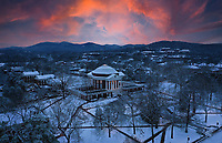 The sun sets behind an illuminated and snow covered Rotunda at the University of Virginia in Charlottesville, Va. Photo/Andrew Shurtleff Photography, LLC.