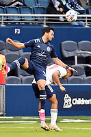 KANSAS CITY, KS - MAY 16: Luis Martins #36 Sporting KC wins the header during a game between Vancouver Whitecaps and Sporting Kansas City at Children's Mercy Park on May 16, 2021 in Kansas City, Kansas.