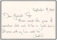 BNPS.co.uk (01202 558833)<br /> Pic: RR Auction/BNPS<br /> <br /> Pictured: A note on the whale from Jackie Kennedy<br /> <br /> A prized scrimshaw whale tooth which JFK displayed on his desk at the Oval Office has emerged for sale for £22,000. ($30,000)<br /> <br /> The 6.5ins rarity depicts a bark-rigged Yankee whaler boat with sails scanning the horizon for spouting whales.<br /> <br /> President John Kennedy was a passionate scrimshaw collector and this example took pride of place in the White House until his assassination in 1963.<br /> <br /> A year later, his widow Jackie Kennedy gave it to an admired US general as a token of appreciation for his 'devotion to country and President Kennedy'.<br /> <br /> The sperm whale tooth, which is 4.25ins in diameter, is being offered for sale for the first time with RR Auction, of Boston, US.