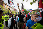 """© Joel Goodman - 07973 332324 . 22/08/2015 . Manchester , UK . A far-right supporter (c) gives a Nazi salute . Far-right nationalist group , """" North West Infidels """" and Islamophobic , anti-Semitic and white supremacist supporters , hold a rally in Manchester City Centre . Photo credit : Joel Goodman"""
