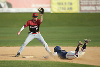 Deep River Muddogs shortstop Alec Bell (10) (Pfeiffer University) fields a throw as Jeremy Simpson (9) (Catawba) of the High Point-Thomasville HiToms slides into second base at Finch Field on June 27, 2020 in Thomasville, NC.  The HiToms defeated the Muddogs 11-2. (Brian Westerholt/Four Seam Images)