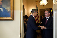 President Barack Obama welcomes Prime Minister Recep Tayyip Erdoguan of Turkey to the Oval Office, Dec. 7, 2009.  (Official White House Photo by Pete Souza)<br /> <br /> This official White House photograph is being made available only for publication by news organizations and/or for personal use printing by the subject(s) of the photograph. The photograph may not be manipulated in any way and may not be used in commercial or political materials, advertisements, emails, products, promotions that in any way suggests approval or endorsement of the President, the First Family, or the White House.