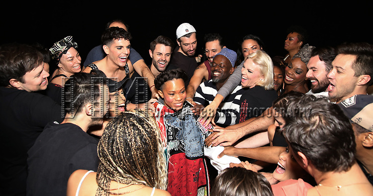 """Bahiyah Hibah with the cast during the Broadway Opening Night Legacy Robe Ceremony honoring Bahiyah Hibah for  """"Moulin Rouge! The Musical"""" at the Al Hirschfeld Theatre on July 25,2019 in New York City."""