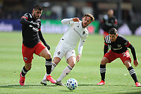 WASHINGTON, DC - FEBRUARY 29: Washington, D.C. - February 29, 2020: Ulises Segura #8 of D.C. United battles the ball with Sam Nicholson #28 of the Colorado Rapids.  The Colorado Rapids defeated D.C. Untied 2-1 during their Major League Soccer (MLS)  match at Audi Field during a game between Colorado Rapids and D.C. United at Audi Field on February 29, 2020 in Washington, DC.