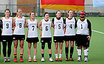 FRANKFURT AM MAIN, GERMANY - April 14: Kristina Schaefer #9 of Germany, Inga Hupka #8 of Germany, Pia Balz #7 of Germany, Mareile Kriwall #6 of Germany, Henrike Voigt #5 of Germany, Jella Kandziora #4 of Germany and Sabine Paul #1 of Germany during the national anthem before the Deutschland Lacrosse International Tournament match between Germany vs Great Britain during the on April 14, 2013 in Frankfurt am Main, Germany. Great Britain won, 10-9. (Photo by Dirk Markgraf)