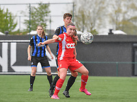 Davinia Vanmechelen (25) of Standard  pictured fighting for the ball with Isabelle Iliano (18) of Club Brugge during a female soccer game between Club Brugge Dames YLA and Standard Femine de Liege on the seventh matchday in Play-Off 1 of the 2020 - 2021 season of Belgian Scooore Womens Super League , saturday 15 May 2021  in Brugge , Belgium . PHOTO SPORTPIX.BE | SPP | DAVID CATRY