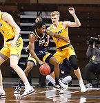 SIOUX FALLS, SD - MARCH 7: Marvin Nesbitt Jr. #33 of the UMKC Kangaroos backs into Sam Griesel #5 of the North Dakota State Bison during the Summit League Basketball Tournament at the Sanford Pentagon in Sioux Falls, SD. (Photo by Richard Carlson/Inertia)