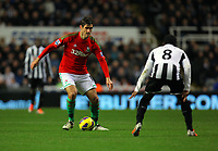 Saturday 17 November 2012<br /> Pictured: Danny Graham of Swansea against Vurnon Anita of Newcastle<br /> Re: Barclay's Premier League, Newcastle United v Swansea City FC at St James' Park, Newcastle Upon Tyne, UK.