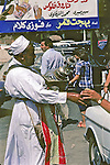 Man Serving Tamr Hendy