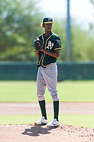 Oakland Athletics relief pitcher Wilkin Ramos (50) gets ready to deliver a pitch during an Instructional League game against the Los Angeles Dodgers at Camelback Ranch on September 27, 2018 in Glendale, Arizona. (Zachary Lucy/Four Seam Images)