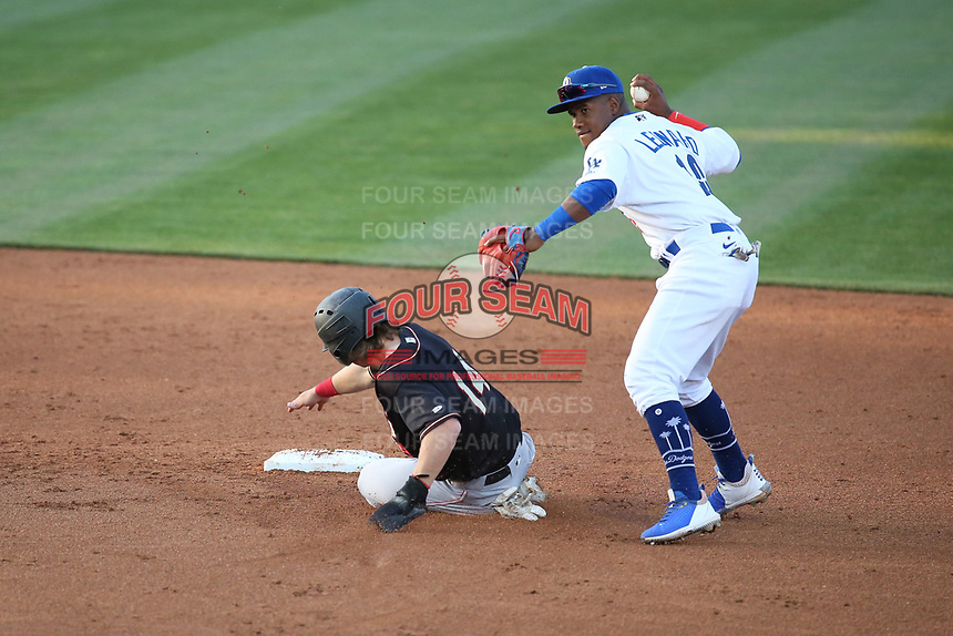 Eddys Leonard (10) of the Rancho Cucamonga Quakes throws to first base after forcing out Matt Scheffler (14) of the Modesto Nuts at LoanMart Field on May 14, 2021 in Rancho Cucamonga, California. (Larry Goren/Four Seam Images)