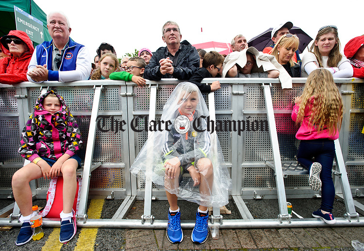 Sean Fennell is well covered up for the weather at the official opening of the All-Ireland Fleadh 2017 in Ennis. Photograph by John Kelly.