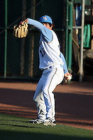Myrtle Beach Pelicans pitcher Cody Buckel #16 warming up in the outfield before a game against the Potomac Nationals at Tickerreturn.com Field at Pelicans Ballpark on April 12, 2012 in Myrtle Beach, South Carolina. Myrtle Beach defeated Potomac by the score of 1-0. (Robert Gurganus/Four Seam Images)