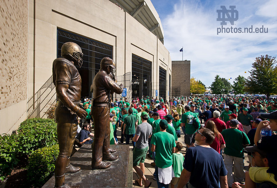 Sept. 28, 2013; Fans enter Notre Dame Stadium through the Lou Holtz gate past the eponymous statue.<br /> <br /> Photo by Matt Cashore/University of Notre Dame
