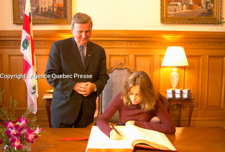 August 30, 2001, Montreal, Quebec, Canada<br /> <br /> Pierre Bourque, Montreal Mayor (at that time)  (L) look a tEmmanuelle Beart (BÈart), French actress and President of the 25th World Film Festival Jury (Festival des Films du Monde) as she sign the Montreal's gold book during a reception at Montreal City Hall  August 30 , 2001 in Montreal, CANADA.<br />  <br /> Mandatory Credit: Photo by Pierre Roussel- Images Distribution. (©) Copyright 2001 by Pierre Roussel <br /> ON SPEC<br /> NOTE l Nikon D-1 jpeg opened with Qimage icc profile, saved in Adobe 1998 RGB.