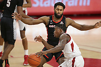 Arkansas guard Davonte Davis (4) drives the ball as Georgia Andrew Garcia (4) blocks, Saturday, January 9, 2021 during the first half of a basketball game at Bud Walton Arena in Fayetteville. Check out nwaonline.com/210110Daily/ for today's photo gallery. <br /> (NWA Democrat-Gazette/Charlie Kaijo)