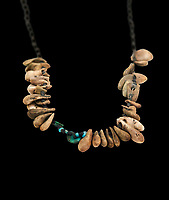 Neolithic stone necklace, 7000 BC to 6500 BC . Catalhoyuk collection, Konya Archaeological Museum, Turkey. Against a black background