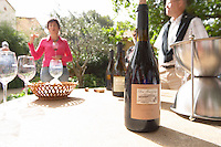 clos m bottle on a table for wine tasting domaine montirius vacqueyras rhone france
