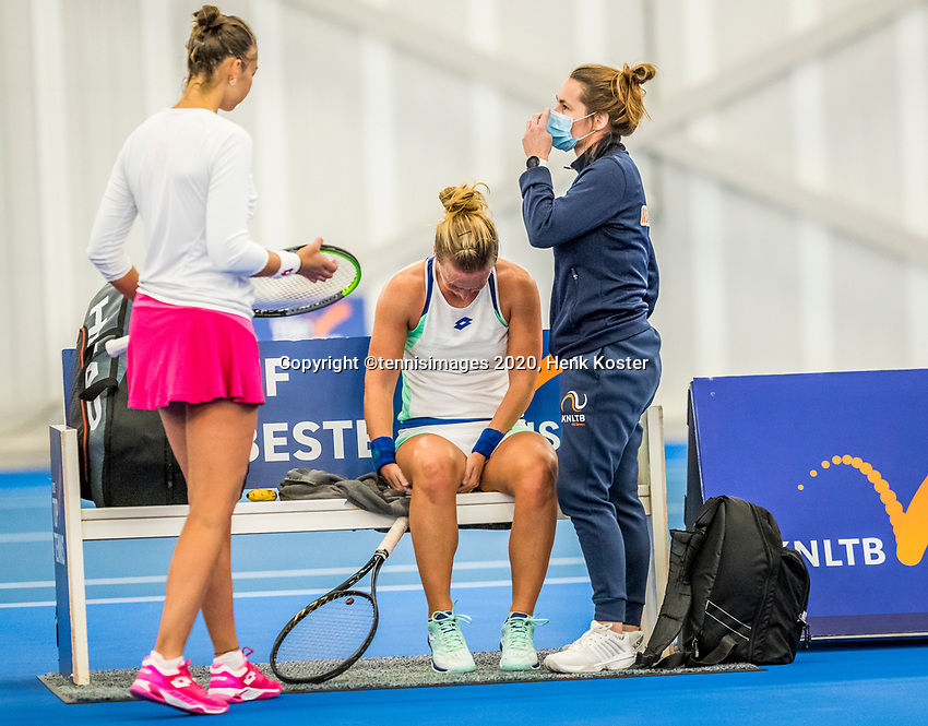 Amstelveen, Netherlands, 20  December, 2020, National Tennis Center, NTC, NK Indoor, National  Indoor Tennis Championships, Final womans single  :    Richel Hogenkamp (NED) does a split and injures  her hamstring	<br />