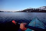 Alaska, Sea kayaker explores Alaska's Prince William Sound's Knight Island Passage.