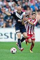 MELBOURNE, AUSTRALIA - DECEMBER 11: Adrian Zahra of the Heart is fouled by Kevin Muscat of the Victory during the round 18 A-League match between the Melbourne Heart and Melbourne Victory at AAMI Park on December 11, 2010 in Melbourne, Australia. (Photo by Sydney Low / Asterisk Images)