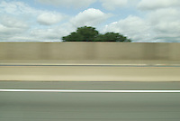 AVAILABLE FROM JEFF AS A FINE ART PRINT.<br /> <br /> AVAILABLE FROM PLAINPICTURE FOR COMMERCIAL AND EDITORIAL LICENSING. Please go to www.plainpicture.com and search for image # p5690164.<br /> <br /> Blurred Empty Highway Viewed from a Moving Vehicle, New Jersey Turnpike, Central New Jersey, USA