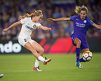 Orlando, FL - Saturday March 24, 2018: Utah Royals Gunnhildur Jonsdottir (23) has her shot deflected by Orlando Pride midfielder Dani Weatherholt (17) during a regular season National Women's Soccer League (NWSL) match between the Orlando Pride and the Utah Royals FC at Orlando City Stadium. The game ended in a 1-1 draw.