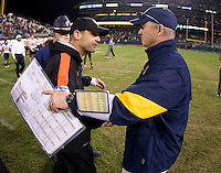 California head coach Jeff Tedford shakes hands with Oregon State head coach Mike Riley after the game at AT&T Park in San Francisco, California on November 12th, 2011.   California defeated Oregon State, 23-6.