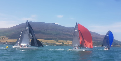 Costa del Carlingford – idyllic racing in Carlingford Lough in the SB20 Northerns with (foreground) Mel Collins chasing Eoin Leahy