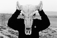 """Azerbaijan. Baku Region. Lokbatan is distant 20 km from Baku. A man, working and wearing a BP pullover, poses with a dead buffalo's head. BP, formerly known as British Petroleum, is a British energy company, a multinational oil company (""""oil major""""). The company is among the largest private sector energy corporations in the world.  © 2007 Didier Ruef"""