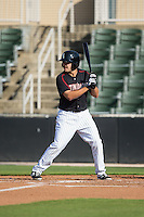 Christian Stringer (9) of the Kannapolis Intimidators at bat against the West Virginia Power at CMC-Northeast Stadium on April 21, 2015 in Kannapolis, North Carolina.  The Power defeated the Intimidators 5-3 in game one of a double-header.  (Brian Westerholt/Four Seam Images)