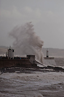 Saturday 08 February 2014<br /> Pictured: Porthcawl Lighthouse takes a battering from the storm<br /> Re: Storms once again batter the coast at Porthcawl, South Wales
