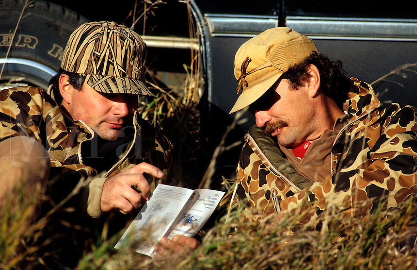 Duck hunters review Minnesota waterfowl hunting regulations.