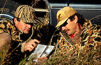 Duck hunters review Minnesota waterfowl hunting regulations.