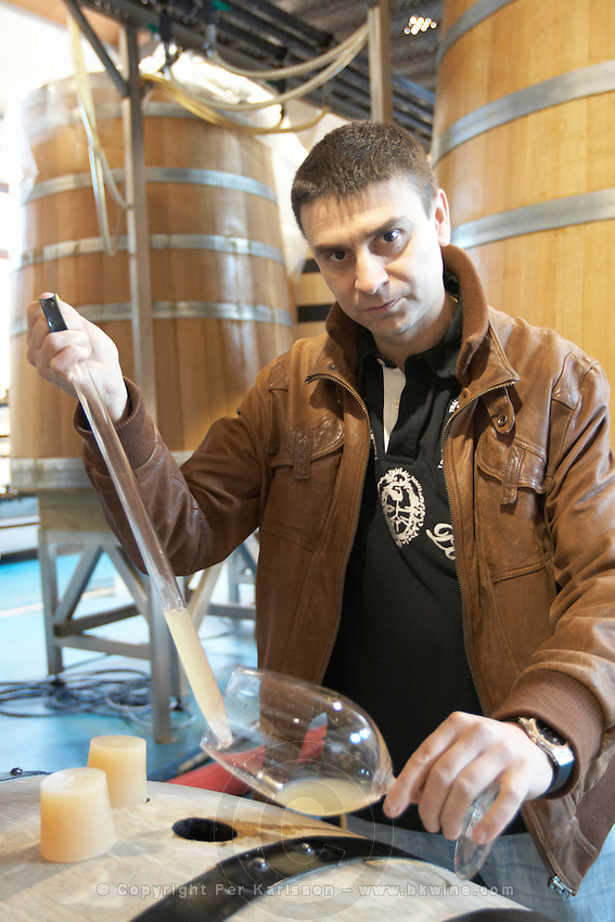 sampling wine with a pipette from a barrel eugenio gonzalez rubio Bodegas Margon , DO Tierra de Leon , Pajares de los Oteros spain castile and leon