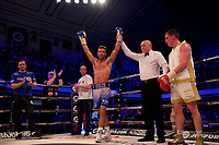 Felix Cash ( blue shorts) gets the point decision over Jay Byrne ( white/gold shorts) during their  Middleweight contest in the Matchroom Boxing JDNXTGEN Series event  at York Hall, Bethnal Green, England on 17 March 2017. Photo by Alan  Stanford.