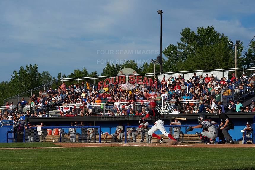 Batavia Muckdogs shortstop Anfernee Seymour (3) at bat in front catcher Li-Jen Chu and umpire Tyler Jones with a large crowd during a game against the Mahoning Valley Scrappers on July 3, 2015 at Dwyer Stadium in Batavia, New York.  Batavia defeated Mahoning Valley 7-4.  (Mike Janes/Four Seam Images)