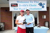 CHAPEL HILL, NC - OCTOBER 13: Kenzie Wright of the University of Alabama is presented with the individual runner-up trophy by head coach Jan Mann of the University of North Carolina at UNC Finley Golf Course on October 13, 2019 in Chapel Hill, North Carolina.
