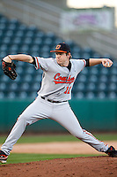Kyle Bagnell (12) of the Oklahoma State Cowboys delivers a pitch during a game against the Missouri State Bears at Hammons Field on March 6, 2012 in Springfield, Missouri. (David Welker / Four Seam Images)