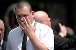Upset mourners at the funeral of Stuart Cable at St Elvan's Church in the centre of Aberdare today. The former Stereophonics drummer was found dead at his home on 7th June.