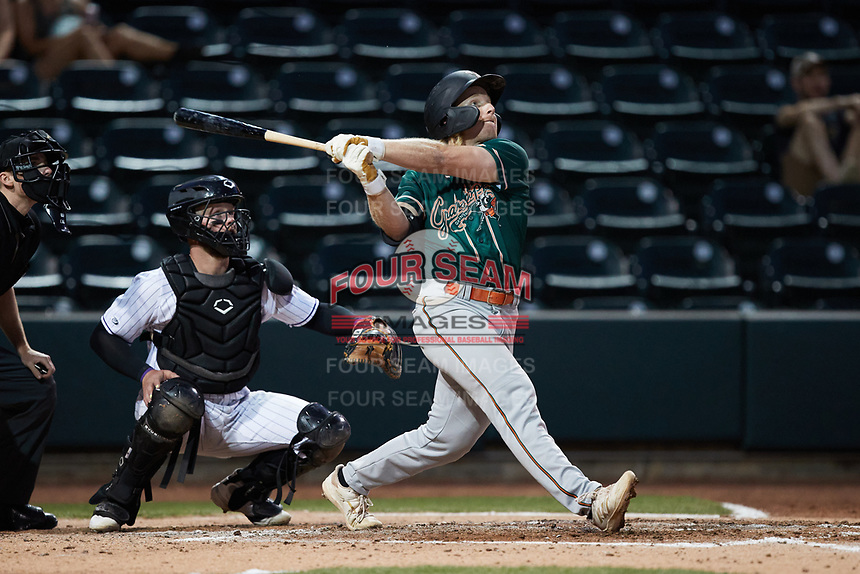 Aaron Shackelford (44) of the Greensboro Grasshoppers follows through on his swing against the Winston-Salem Dash at Truist Stadium on June 17, 2021 in Winston-Salem, North Carolina. (Brian Westerholt/Four Seam Images)