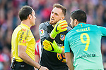 Goalkeeper Jan Oblak (c) of Atletico de Madrid speaks to the referee Antonio Mateu Lahoz (l) as Luis Suarez of FC Barcelona looks on during their La Liga match between Atletico de Madrid and FC Barcelona at the Santiago Bernabeu Stadium on 26 February 2017 in Madrid, Spain. Photo by Diego Gonzalez Souto / Power Sport Images