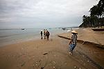 A group of fishermen haul in a net on the beach in Mui Ne, Vietnam. Nov. 20, 2011.