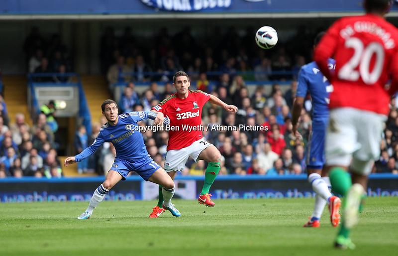Pictured: Angel Rangel and Chelsea's Eden hazard<br /> Barclays Premier League, Chelsea FC (blue) V Swansea City,<br /> 28/04/13
