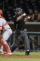 Umpire Ryan Blakney makes a call during an Arizona Fall League game between the Mesa Solar Sox and Peoria Javelinas on October 16, 2014 at Cubs Park in Mesa, Arizona.  Mesa defeated Peoria 6-2.  (Mike Janes/Four Seam Images)