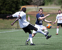 The UNC Greensboro Spartans played the University of South Carolina Gamecocks in The Manchester Cup on April 5, 2014.  The teams played to a 0-0 tie.  Nicholas Downs (14), Mahamoudou Kaba (6)