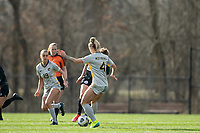 LOUISVILLE, KY - MARCH 13: Savannah McCaskill #7 of Racing Louisville FC and Juliana Lynch #4 of West Virginia University battle for the ball during a game between West Virginia University and Racing Louisville FC at Thurman Hutchins Park on March 13, 2021 in Louisville, Kentucky.
